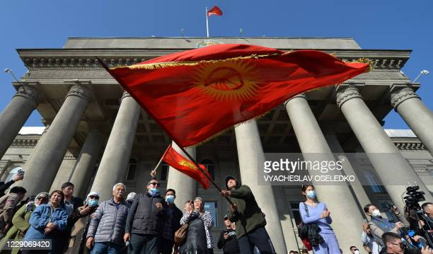 Supporters of newly appointed Prime Minister Sadyr Japarov waves Kyrgyz flags during a rally in support of Japarov in Bishkek on October 14 2020...