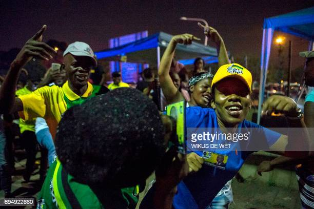 Supporters of newly elected African National Congress President Cyril Ramaphosa celebrate outside The NASREC Expo Centre where the 54th ANC National...