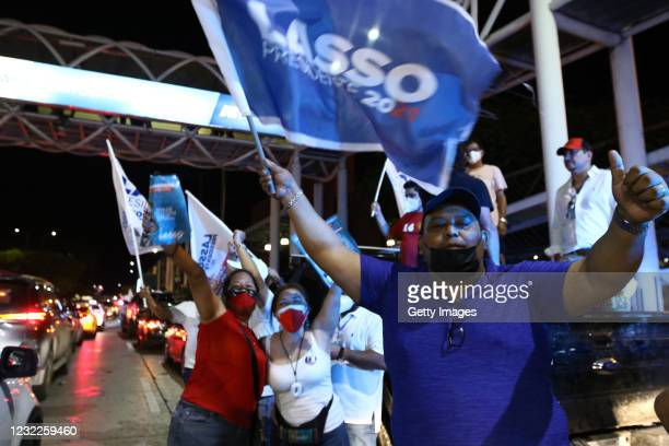 Supporters of newly elected President of Ecuador Guillermo Lasso celebrate in the streets after winning the presidential runoff against candidate of...