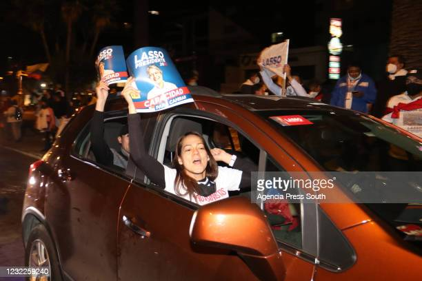 Supporters of newly elected President of Ecuador Guillermo Lasso celebrate after winning the presidential runoff against candidate of Unión Por La...