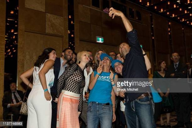 Supporters of newly reelected NSW Premiere Gladys Berejiklian celebrate with a selfie at the Sofitel Wentworth on March 23 2019 in Sydney Australia...