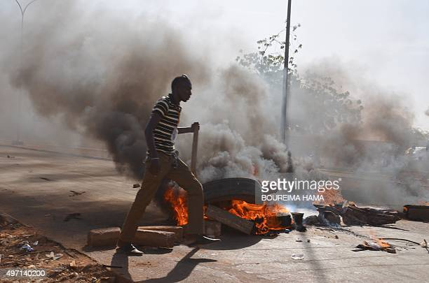 Supporters of Niger presidential candidate Hama Amadou burn tyres during a protest in Niamey on November 14 after opposition Niger presidential...