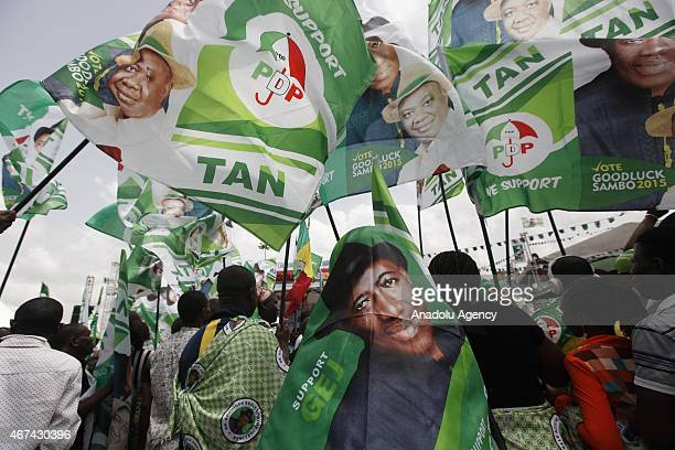 Supporters of Nigerian President Goodluck Jonathan and candidate of the ruling Peoples Democratic Party attend an election campaign rally in Lagos...
