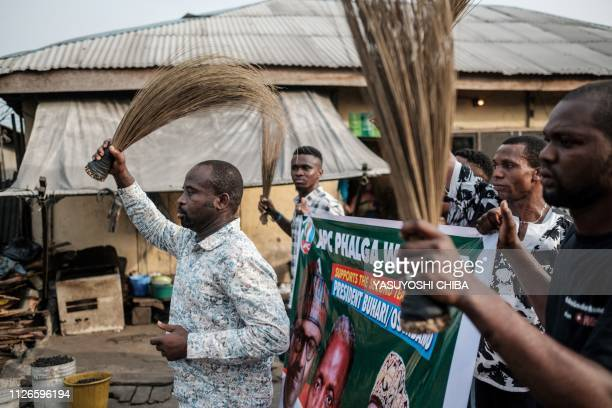 Supporters of Nigeria's incumbent President's party the All Progressives Congress march on a street in Port Harcourt, the opposition stronghold,...