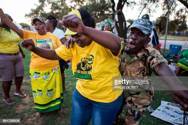 Supporters of Nkosazana DlaminiZuma dance outside NASREC Expo Centre during the 54th African National Congress National Conference in Johannesburg on...