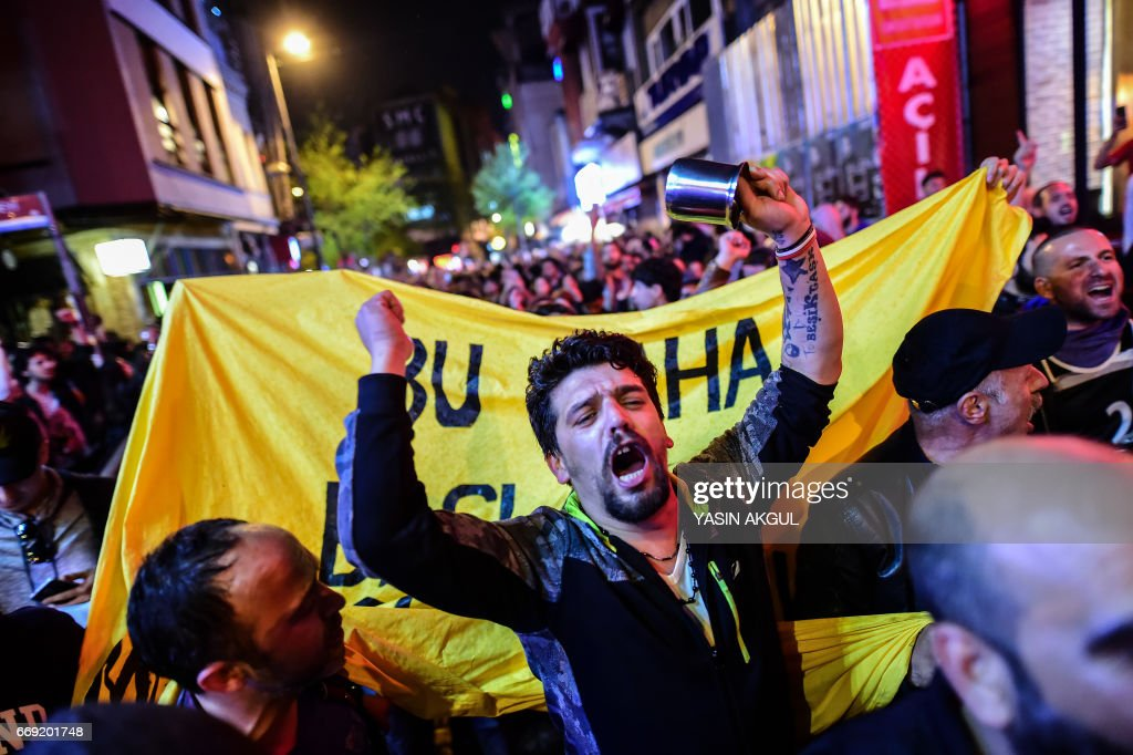 TOPSHOT - Supporters of 'No' gather in Istanbul to protest on April 16, 2017 after the results of a nationwide referendum that will determine Turkey's future destiny. Recep Tayyip Erdogan on April 16, 2017 hailed Turkey for making a 'historic decision' as he claimed victory in the referendum on a new constitution expanding his powers. The 'Yes' campaign to give Turkish President expanded powers won with 51.3 percent of the vote a tightly-contested referendum although the 'No' camp had closed the gap, according to initial results. But Turkey's two main opposition parties said they would challenge the results. /