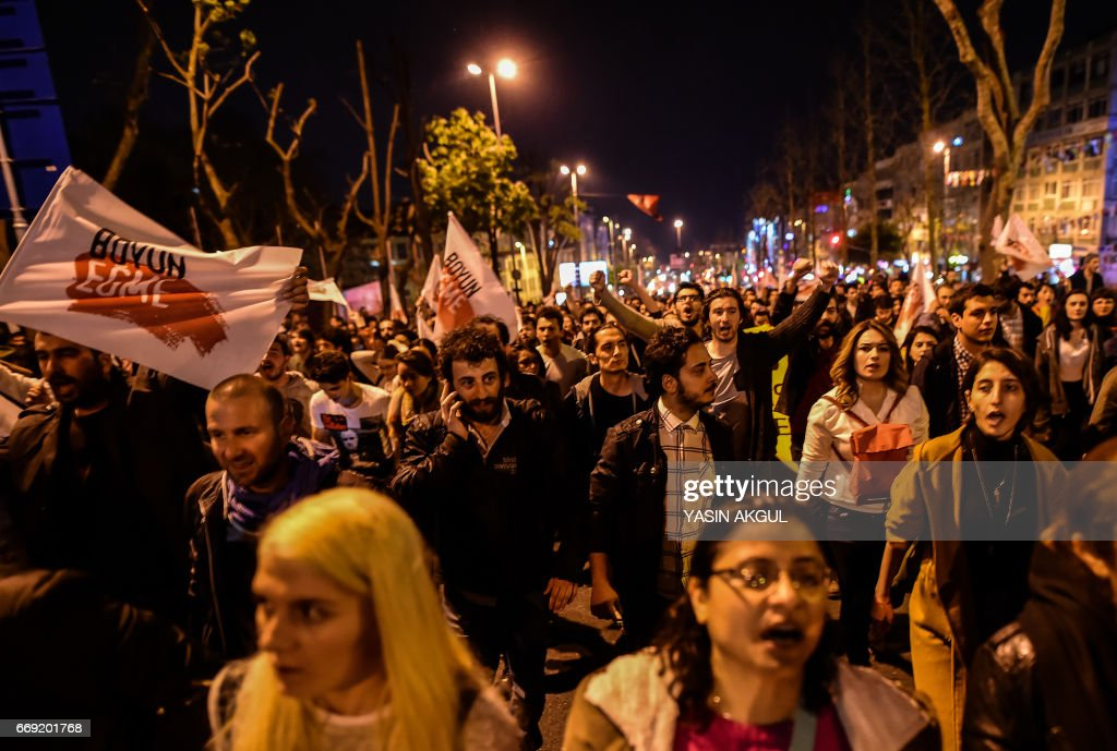 Supporters of 'No' gather in Istanbul to protest on April 16, 2017 after the results of a nationwide referendum that will determine Turkey's future destiny. Recep Tayyip Erdogan on April 16, 2017 hailed Turkey for making a 'historic decision' as he claimed victory in the referendum on a new constitution expanding his powers. The 'Yes' campaign to give Turkish President expanded powers won with 51.3 percent of the vote a tightly-contested referendum although the 'No' camp had closed the gap, according to initial results. But Turkey's two main opposition parties said they would challenge the results. /