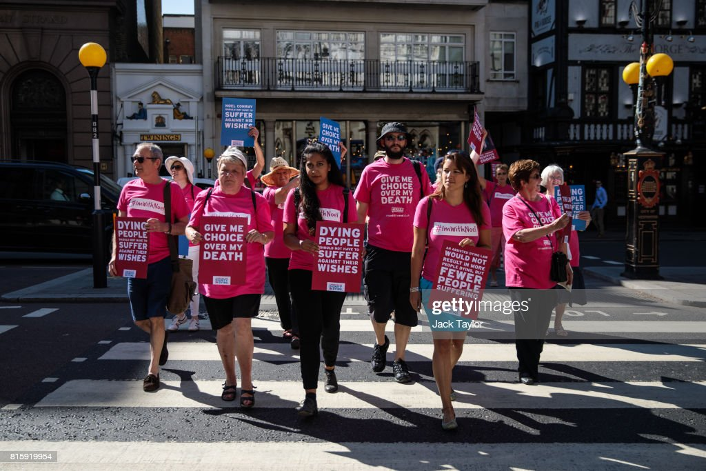 Supporters of Noel Conway from the campaign group Dignity in Dying arrive with placards to the Royal Courts of Justice, Strand on July 17, 2017 in London, England. Mr Conway, 67, who is terminally ill with motor neurone disease, is seeking a legal challenge on the law banning assisted dying.