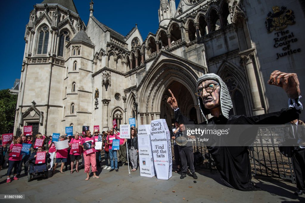 Supporters of Noel Conway from the campaign group Dignity in Dying (L) demonstrate next to a counter protest from the group Distant Voices, who oppose the liberalisation of euthanasia laws (R) outside the Royal Courts of Justice, Strand on July 17, 2017 in London, England. Mr Conway, 67, who is terminally ill with motor neurone disease, is seeking a legal challenge on the law banning assisted dying.