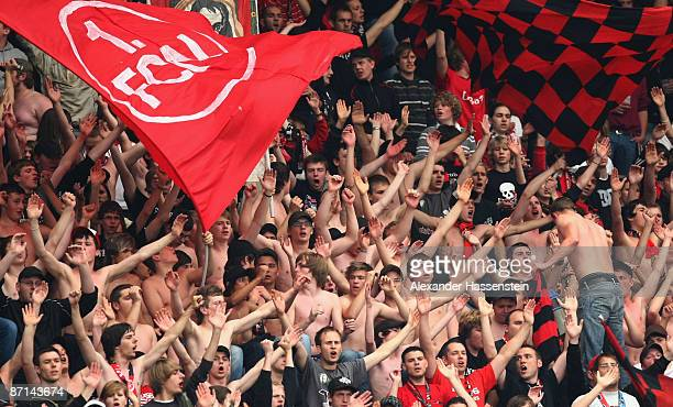 Supporters of Nuernberg celebrate during the Second Bundesliga match between 1. FC Nuernberg and VfL Osnabrueck at the easyCredit stadium on May 13,...