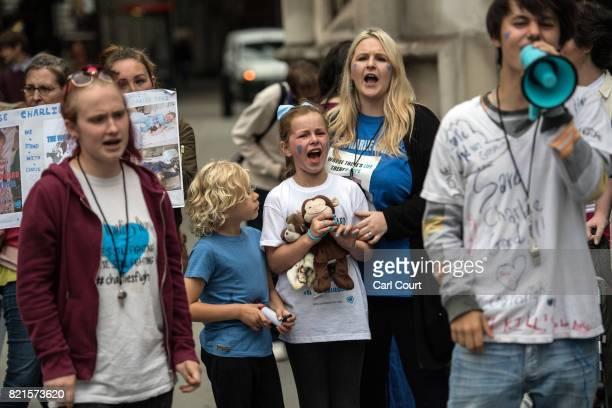 Supporters of of terminally ill baby Charlie Gard protest outside the High Court after the verdict was announced on July 24 2017 in London England...