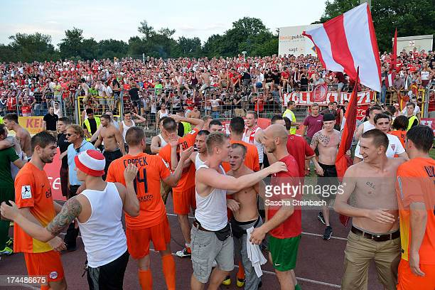 Supporters of Offenbach celebrate winning the Regionalliga Suedwest match between TuS Koblenz and Kickers Offenbach at Conlog Arena on July 26 2013...