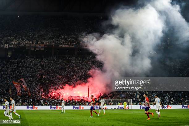 Supporters of Olympique Marseille with banner UEFA MAFIA and fireworks during the UEFA Europa League match between Olympique Marseille v Atletico...