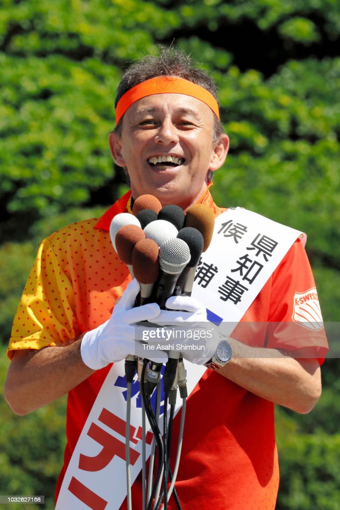Supporters of opposition 'All Okinawa' movement backed candidate Denny Tamaki makes a street speech as the Okinawa gubernatorial election officially kicks off on September 13, 2018 in Ie, Okinawa, Japan. Okinawa people vote in the election to decide the successor of late governor Takeshi Onaga on September 30.