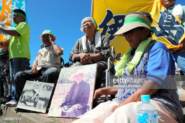 Supporters of opposition 'All Okinawa' movement backed candidate Denny Tamaki wait for a street speech as the Okinawa gubernatorial election...