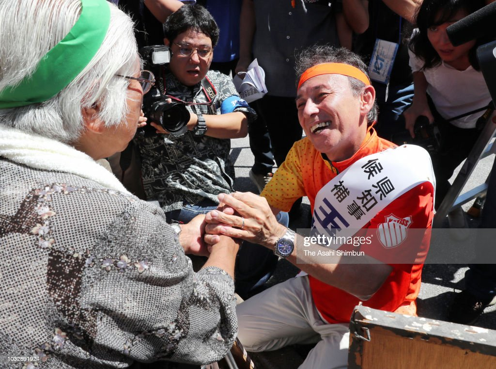 Supporters of opposition 'All Okinawa' movement backed candidate Denny Tamaki visits a hut set up by anti-U.S. Airbase relocation protesters as the Okinawa gubernatorial election officially kicks off on September 13, 2018 in Ie, Okinawa, Japan. Okinawa people vote in the election to decide the successor of late governor Takeshi Onaga on September 30.