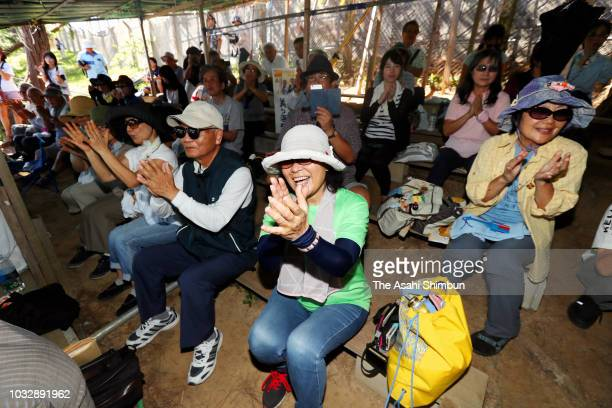 Supporters of opposition 'All Okinawa' movement backed candidate Denny Tamaki visits a hut set up by antiUS Airbase relocation protesters as the...