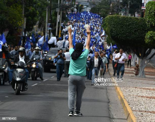 TOPSHOT Supporters of opposition candidate Salvador Nasralla argue with supporters of President Juan Orlando Hernandez in Tegucigalpa on December 7...