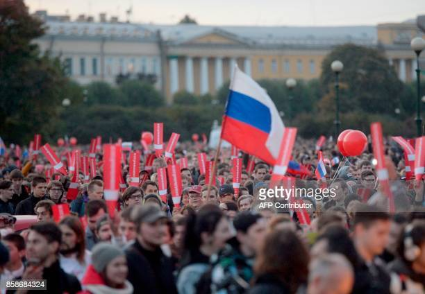 Supporters of opposition leader Alexei Navalny attend an unauthorized rally in Saint Petersburg on October 7 2017 Several thousand supporters of...