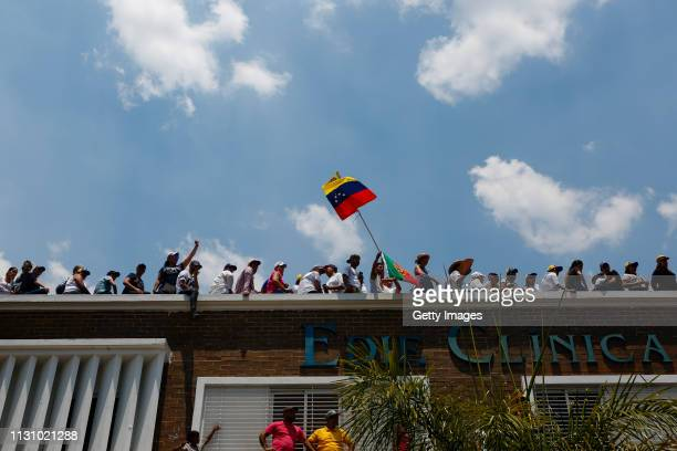 Supporters of opposition leader and Self proclaimed Interim President of Venezuela Juan Guaidó gather on a hospital's rooftop during a Citizens'...