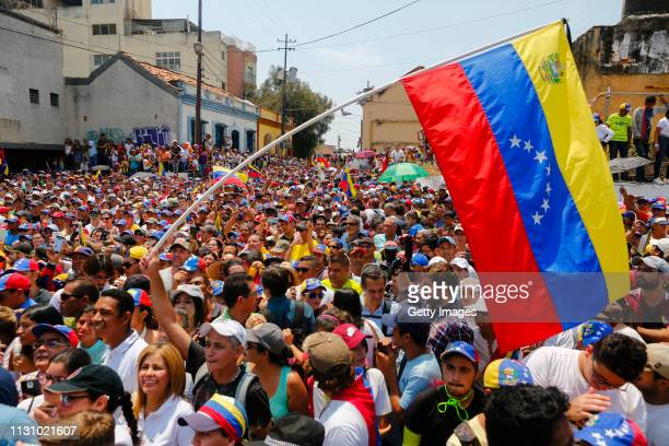 Supporters of opposition leader and Self proclaimed Interim President of Venezuela Juan Guaidó wave a Venezuelan flag as they gather during a...