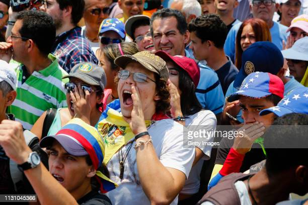Supporters of opposition leader and Self proclaimed Interim President of Venezuela Juan Guaidó chant slogans during a Citizens' Assembly on March 16...