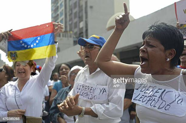 Supporters of opposition leader Leopoldo Lopez who was arrested on the eve on charges of homicide and inciting violence protest outside of the...