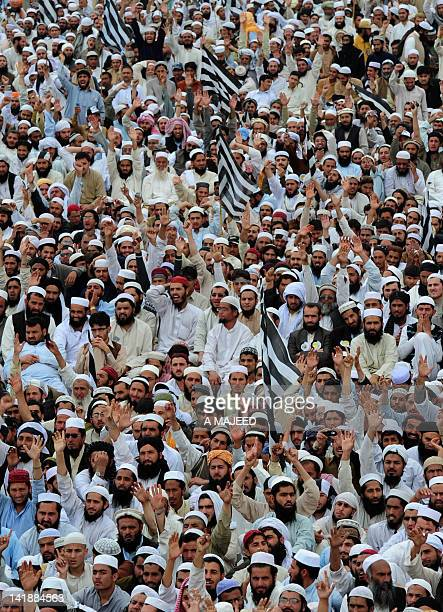 Supporters of opposition leader Maulana FazalurRehman shout slogans during a protest rally in Peshawar on March 25 2012 Parliament will debate on...