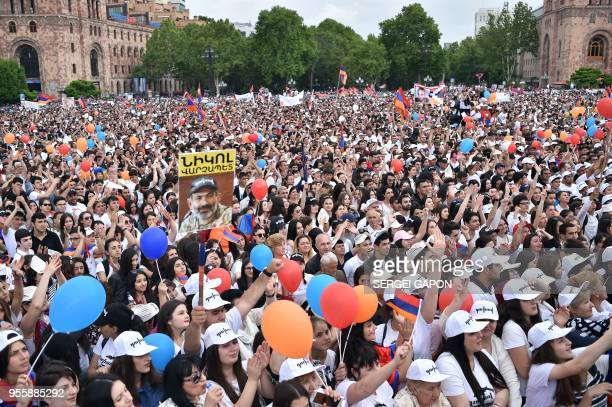 TOPSHOT Supporters of opposition leader Nikol Pashinyan gather on May 8 2018 in Yerevan's central Republic Square as the parliament votes for a...