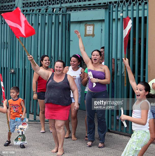 Supporters of opposition Libertarian Movement presidential candidate Otto Guevara flutter flags as he passes by on January 31 in Alajuela 22...