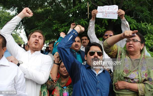 Supporters of opposition party Pakistan TahreekeInsaaf shout slogans following a verdict of Supreme Court in Islamabad Pakistan on July 28 2017...