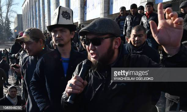 Supporters of opposition politician Amanbol Babakulov take part in a rally against so- called Chinese expansion at the Ala-Too square in Bishkek on...