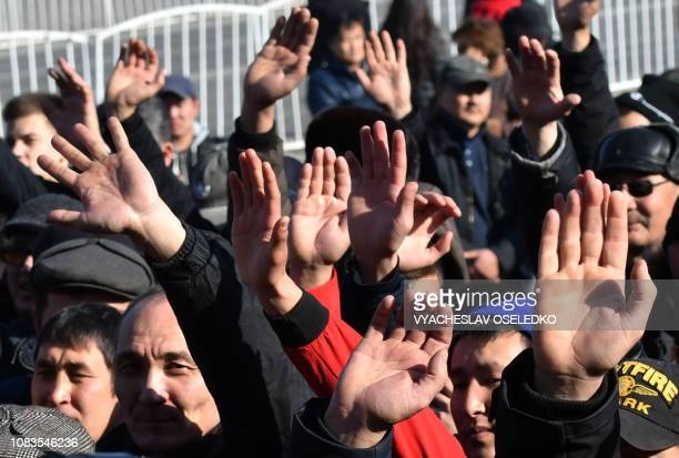 Supporters of opposition politician Amanbol Babakulov take part in a rally against so called Chinese expansion at the AlaToo square in Bishkek on...