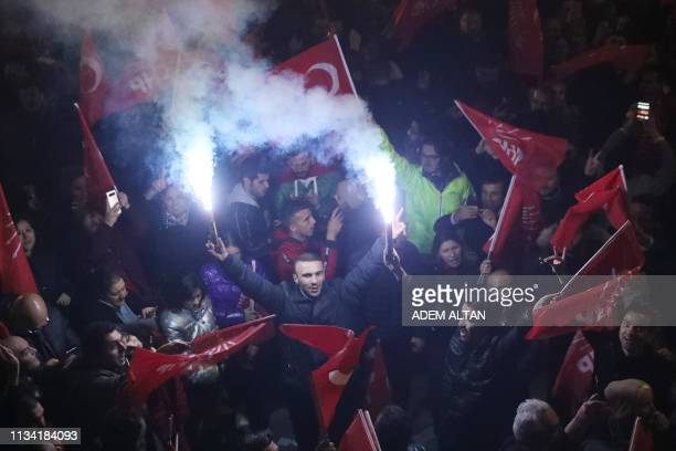 Supporters of opposition Republican People's Party celebrate after early results for Ankara mayor in local election in Ankara, on March 31, 2019. -...