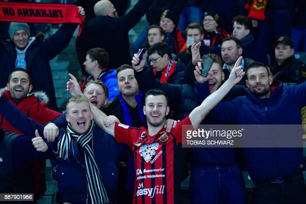 Supporters of Ostersund cheer their team prior to the UEFA Europa League group J football match Hertha BSC Berlin vs Ostersund FK on December 7 2017...