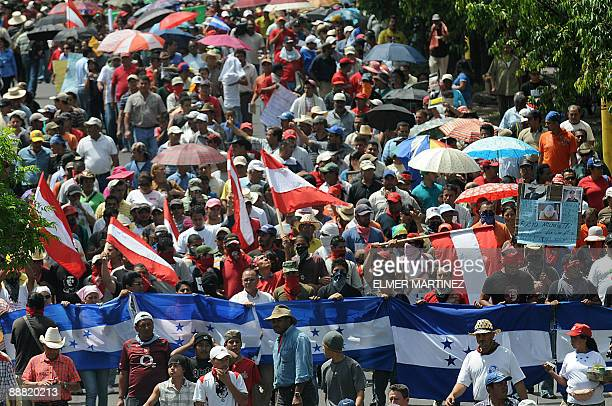Supporters of ousted Honduran President Manuel Zelaya march against the military coup in Tegucigalpa on July 4 2009 The political and diplomatic...