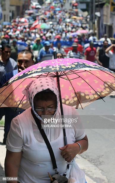 Supporters of ousted Honduran President Manuel Zelaya march during a demonstration demanding his restitution on August 10 2009 in Tegucigalpa US...