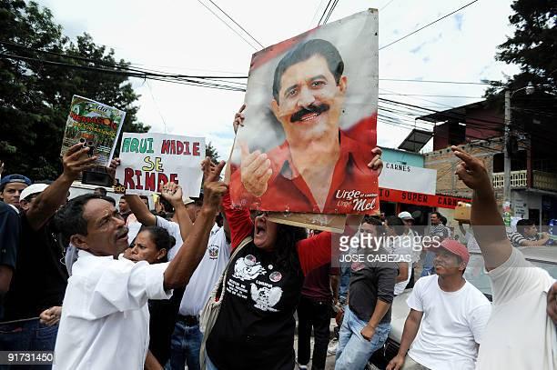 Supporters of ousted Honduran president Manuel Zelaya shout slogans during a protest against the military coup d'etat in El Hato de En medio...