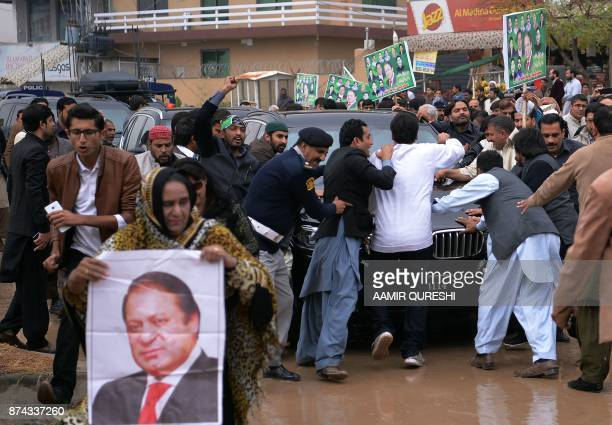 Supporters of ousted Pakistani prime minister Nawaz Sharif surround Sharif's car as he arrives to appear before an accountability court to face...
