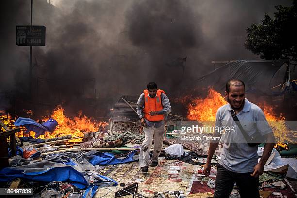 CONTENT] Supporters of ousted president Mohamed Morsi are seen during the violent dispersal of Rabaa Adaweya camp by security forces on August 14th...