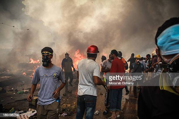 Supporters of ousted president Mohamed Morsi are seen during the violent dispersal of Rabaa Adaweya camp by security forces which left at least 800...