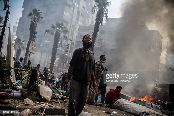 Supporters of ousted president Mohamed Morsi are seen during the violent dispersal of Rabaa Adaweya camp by security forces on August 14th, 2013....