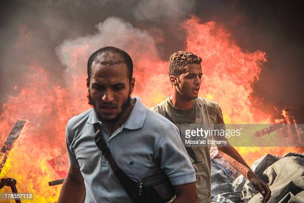 CONTENT] Supporters of ousted president Mohamed Morsi are seen during the clashes that broke out after Egyptian security forces stormed two huge...