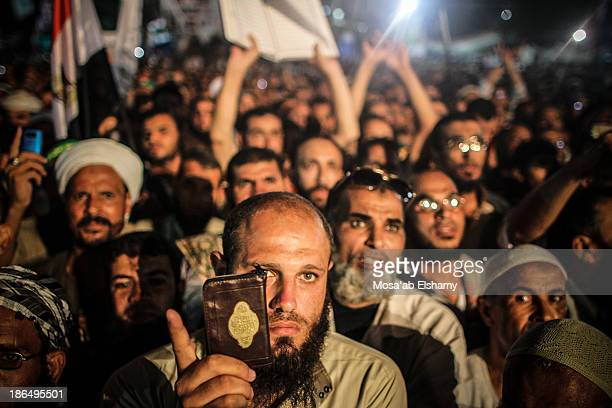 CONTENT] Supporters of ousted president Mohamed Morsi are seen in Rabaa Adaweya camp where they called for his return after the military coup that...