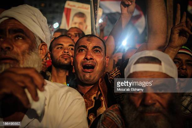 Supporters of ousted president Mohamed Morsi are seen in Rabaa Adaweya camp where they called for his return after the military coup that ousted him...