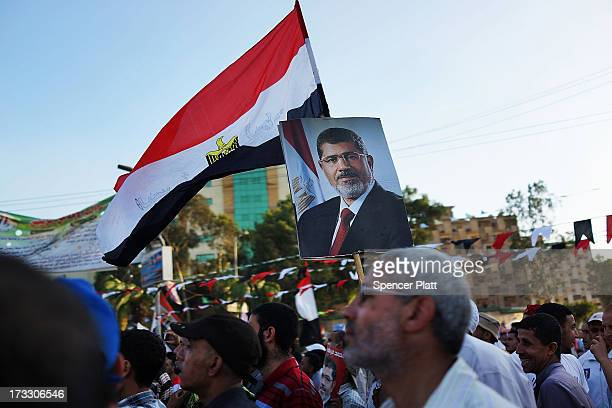 Supporters of ousted president Mohamed Morsi attend a rally before breaking the daily Ramadan fast on the second day of Ramadan, the sacred holy...