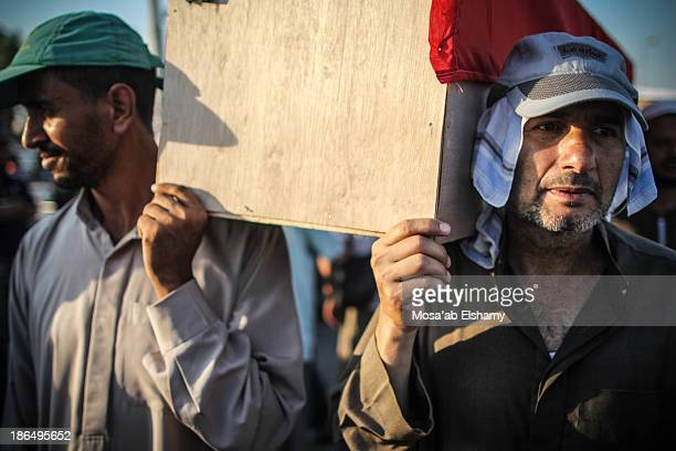 Supporters of ousted president Mohamed Morsi carry symbolic coffins in Rabaa Adaweya square where hundreds of Morsi supporters were killed by...