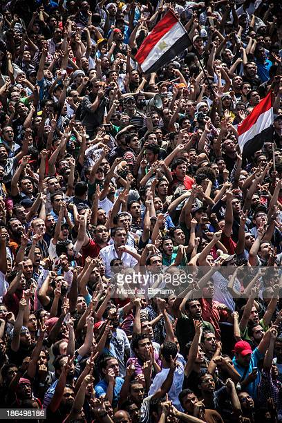 CONTENT] Supporters of ousted president Mohamed Morsi gather at Ramses square to protest the Rabaa massacre