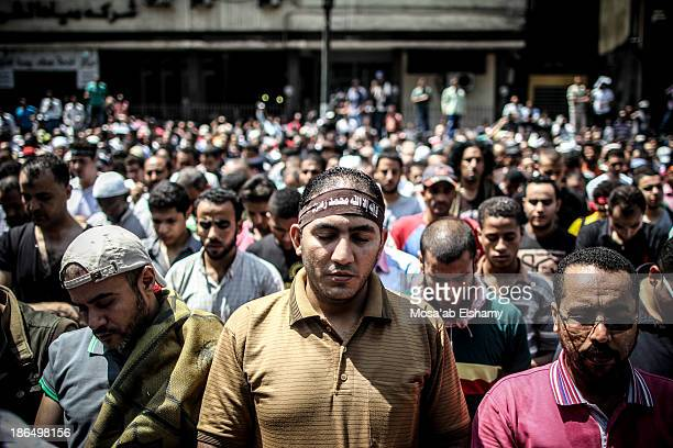 CONTENT] Supporters of ousted president Mohamed Morsi pray at Ramses square on the Day of Rage which was called in reaction to the Rabaa massacre...