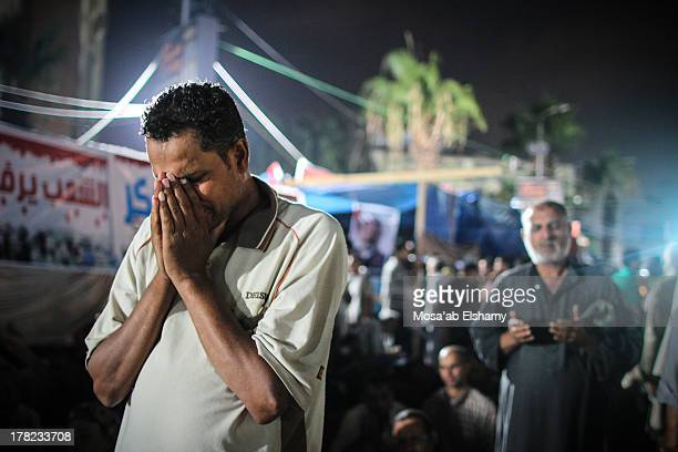 CONTENT] Supporters of ousted president Mohamed Morsi pray during clashes with security forces